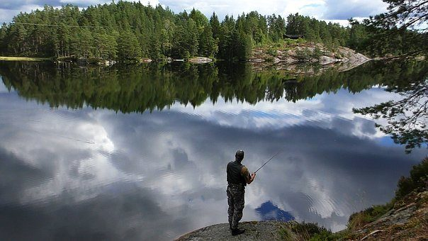 man fishing in a beautiful lake