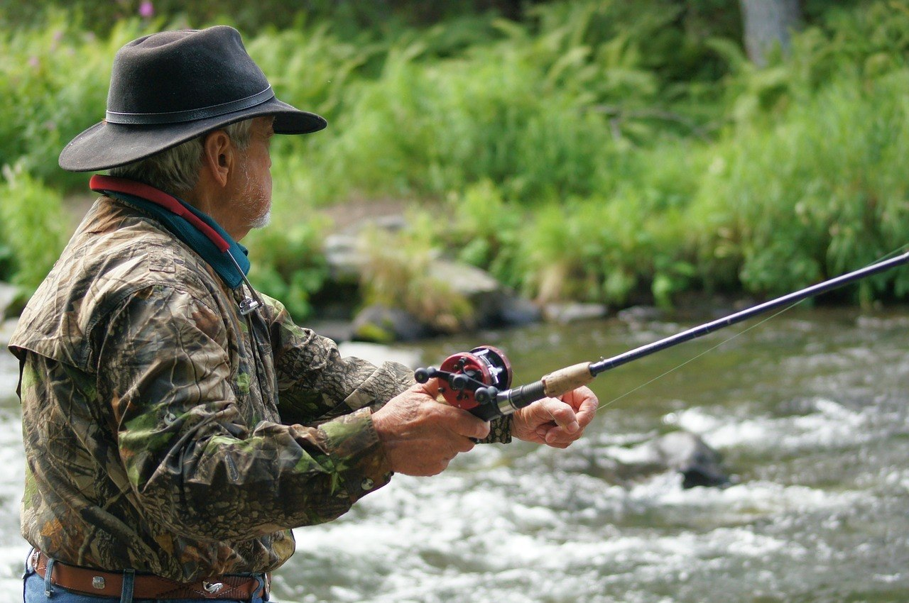 man fishing using one of the best sage fly rods