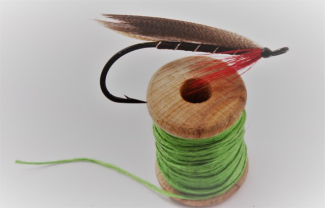 feathered hook om top of thread