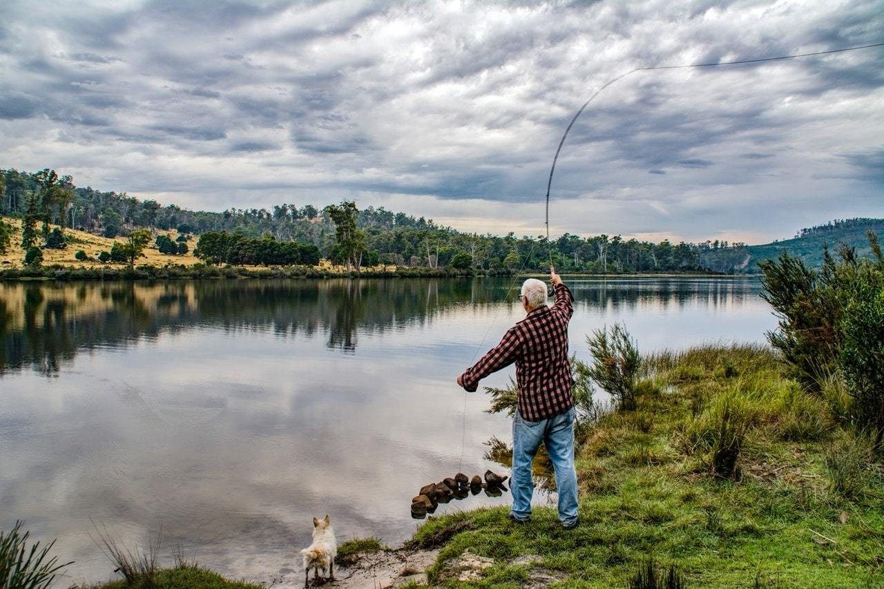 Old man fishing on the lake