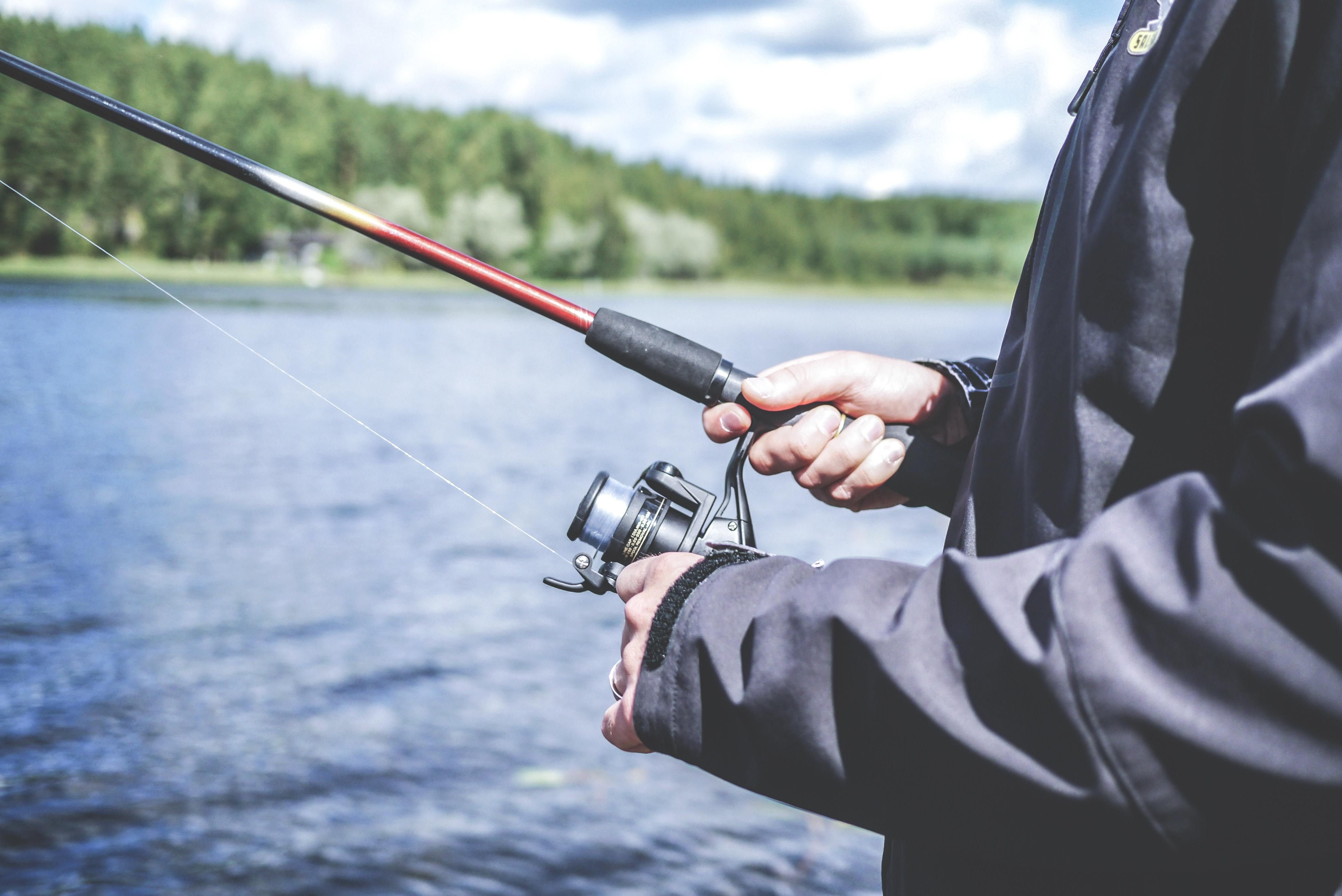 Fisherman holding the best fishing rods